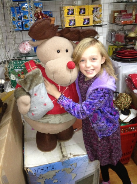 Stephie with one of Santa's reindeer at the Holiday House in Puxi.