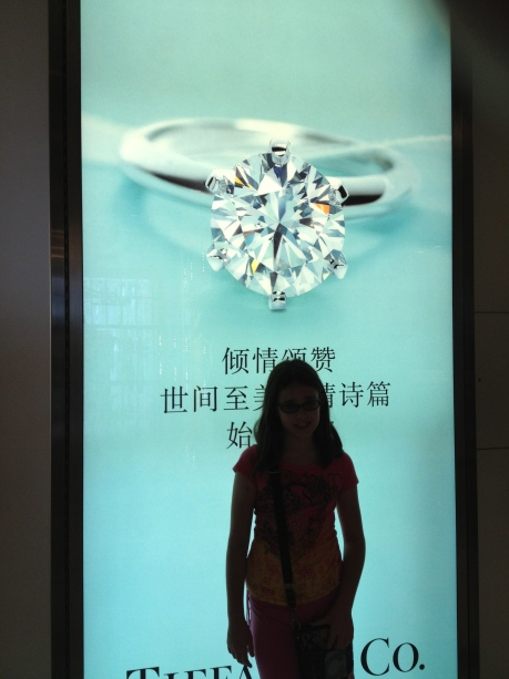 Cassidy back lit in front of Tiffany sign at IFC mall