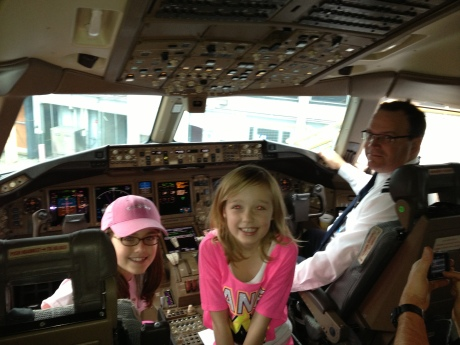 The girls in the cockpit on 777 back to Shanghai after a wonderful trip home