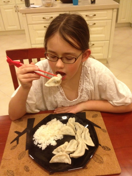 Cassidy eating New Years dumplings.