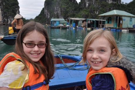 The girls heading toward the floating fishing village, in the background.