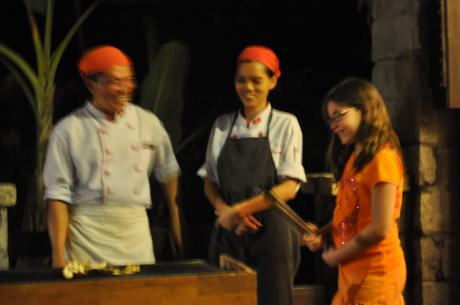 Cassidy helps the chefs at the Chen Sea resort grill the fish for dinner.