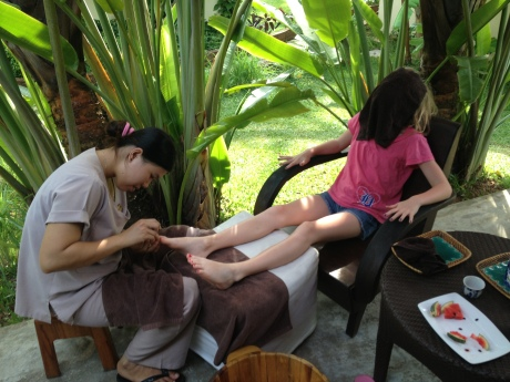 Stephanie, cold towel over her face, gets a mani pedi in paradise.