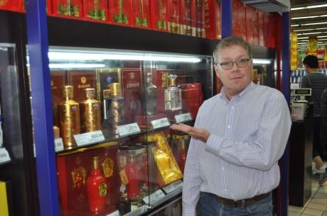High-end Baijiu -- here behind locked glass at Carrefour -- can run up to 2,000RMB ($320) a bottle.
