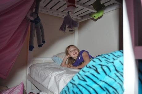 "completely gratuitous shot of Stephanie in the ""fort"" she and her sister built from Cassidy's bunk bed."