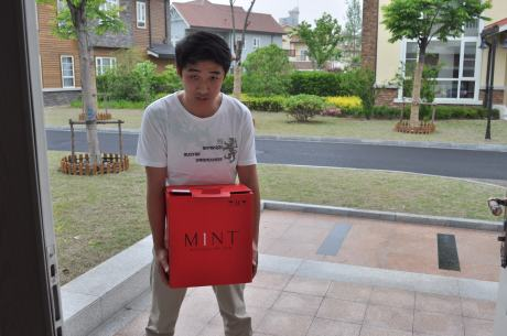 Our driver Steven helping carry in a delivery of wine from the M1nt in their distinctive red boxes.