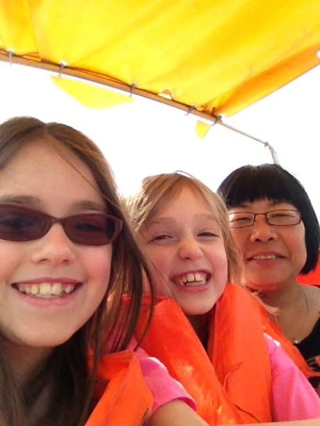 Sunny, our ayi, and the girls in a boat on the lake at Century Park.
