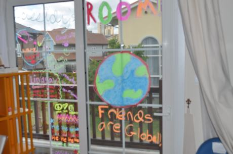 "First day back in Shanghai and Cassidy and friends decorated her door wall, including the phrase ""Friends are global.""  So cool."