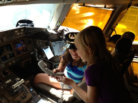 The girls in the cockpit of the 777 that brought us back announcing the flight time to Shanghai (Cassidy with co-pilot's hat).  I hope that isn't against the law....