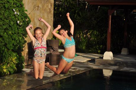The girls jumping in the pool at the villa.  Karen and I are on the chaise lounges sipping Rum drinks, as it should be.