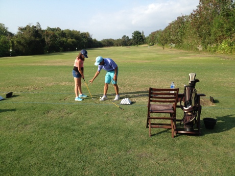 Cassidy having a golf lesson at the beautiful Nirwana golf course.