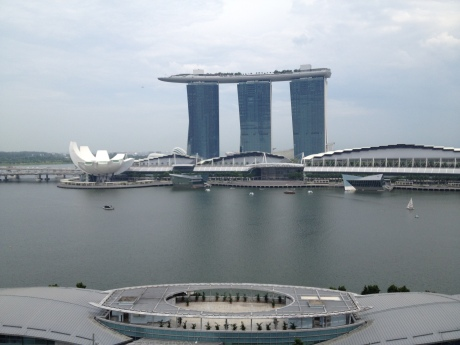 The Marina Bay Sands complex, with the ArtMuseum in front (white), the mall buildings in the middle, and the hotel and casino in the back, with the crazy looking top.