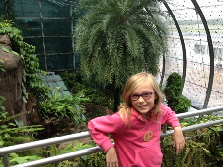 Only in Singapore:  Steph in front of the butterfly garden at the Singapore airport.