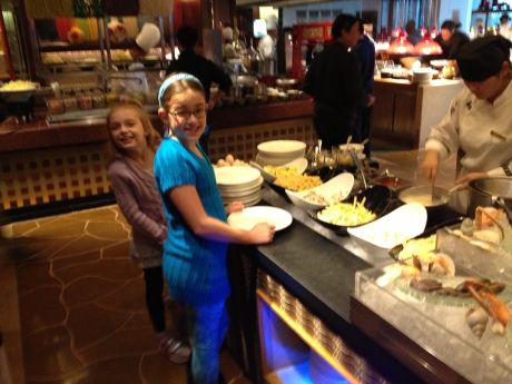 The girls waiting for omelettes at one of 10 kitchens serving brunch at the Yi Cafe in the Shangri-la Hotel in Pudong.