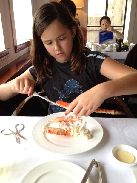 Cassidy digging into her crab legs at the Cathay Room in the Peace Hotel.