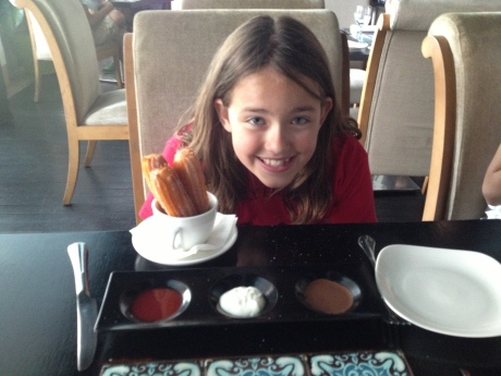 Cassidy getting ready to dig into the churros and accompanying sauces at Maya.