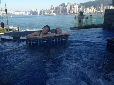 Girls in the hot tub of the Intercontinental, with Hong Kong harbor in the background