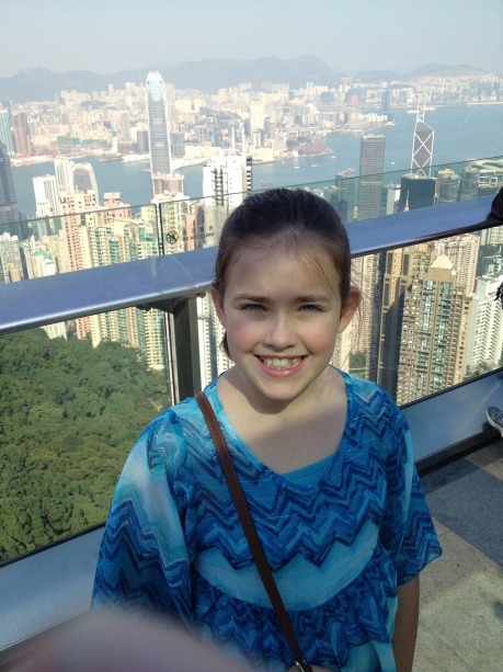Cassidy on Victoria Peak high above Hong Kong, with a view back across the river toward our hotel.