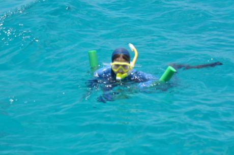 Cassidy snorkeling at the Great Barrier Reef, and watching for giant clams