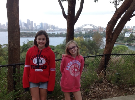 The girls at the Taronga Zoo after the overnight, with Sydney Opera House and Harbor Bridge in the background
