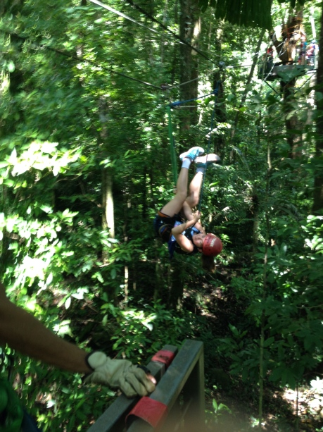One girls coming down out of the rainforest upside down....