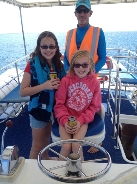 The girls assist the captain on the way to the Great Barrier Reef