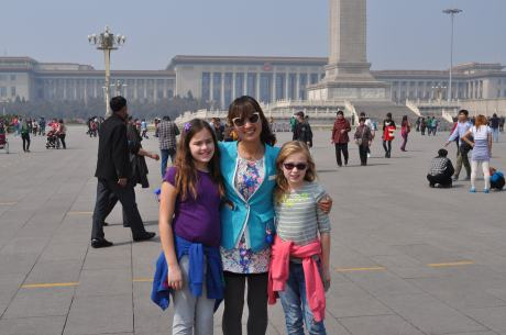 Our fantastic Beijing tour guide Lisa with the girls in Tiananmen Square