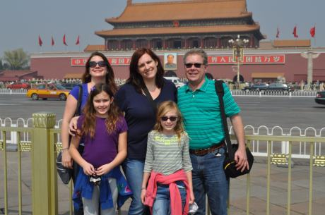 The five of us in Tiananmen Square getting, with the entrance to the Forbidden City behind us