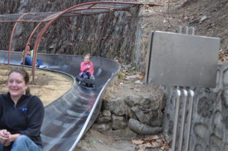 Jenn, Stephanie, and Karen bombing down the toboggan run from atop the Great Wall