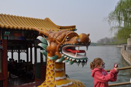Stephie taking a selfie in front of the Dragon Boat