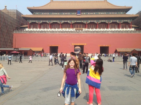 Cassidy in front of the Meridian Gate that leads to the inner temples of the Forbidden City