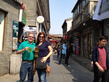 Karen and I roaming a Beijing Hutong, Chinese beer in hand