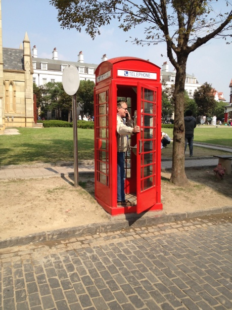 One of the many red phone booths that dot Thames Town, in China