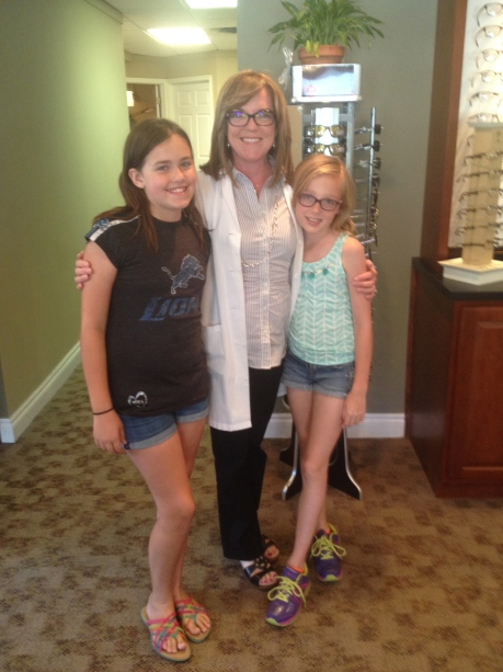 The girls and their optometrist, Dr. Lisa LaGassa, at Pointe Vision Care this summer.