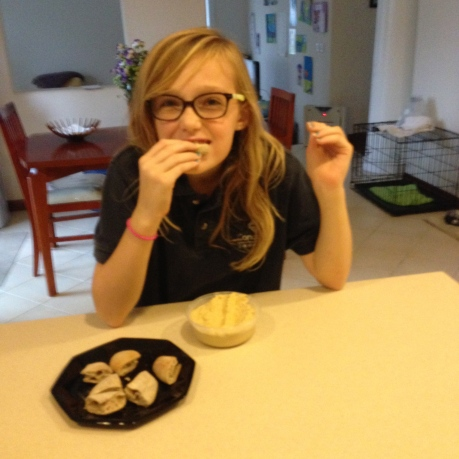 Stephanie eating Len's hummus.   She and her sister Cassidy love it and eat it like it is ice cream.