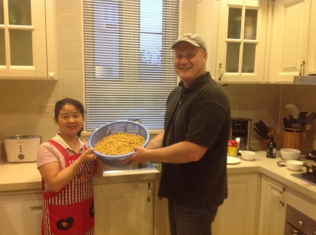 The Hummus Lady - and I'm not talking about the pretty Chinese lady on the left.  Len Pritchett and his ayi Mei Shu Feng holding the Chickpeas that go into his hummus.