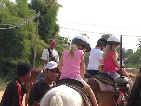 My friend Len's girls saddle up for a ride in the Cambodian countryside.