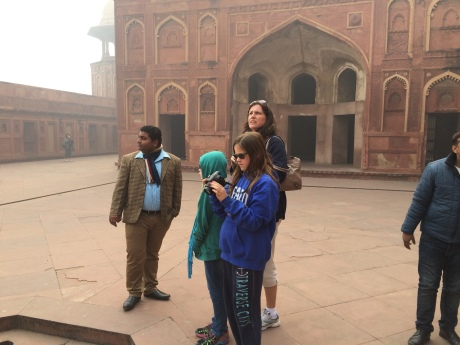 One of our three amazing tour guides, Nitin, showing us the historic Agra Fort.
