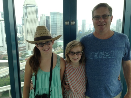 High above the city, on the Singapore Flyer, after our India trip.