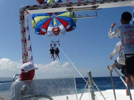 Cassidy and I coming in for a landing after parasailing together in Boracay -- very cool.