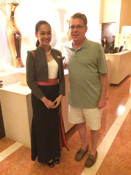 Clarissa and I at the Fairmont Makati's front desk, which she helped us avoid.