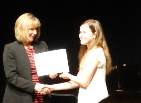 Cassidy receiving her graduation certificate from 8th grade.  It is off to high school in Shanghai!
