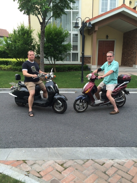 My good friend Scott Orwig on his Western scooter, and I on my near beaten to death Chinese one.