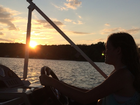 Cassidy driving the boat and giving us a sunset tour of Lake Leelanau.