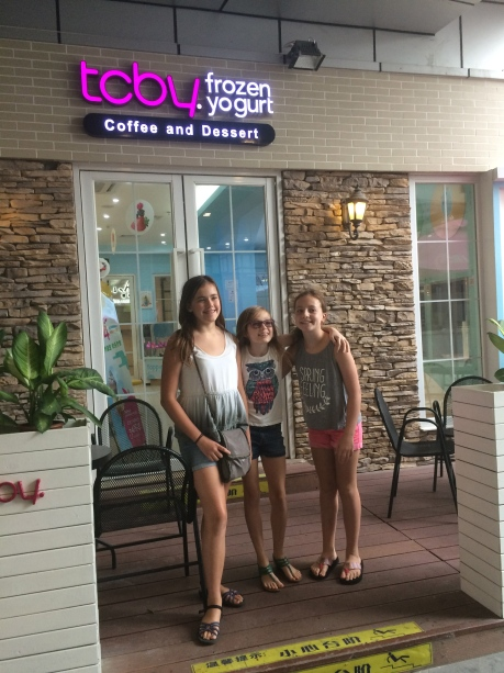 The girls with Stephanie's friend Katie at TCBY in Shanghai, a discovery that had them giddy for a week.