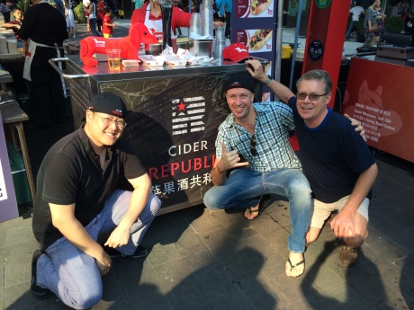 Michael Huang and Leon Mickelson, co-founders of Cider Republic, with their biggest fan at Kerry Beer festival.