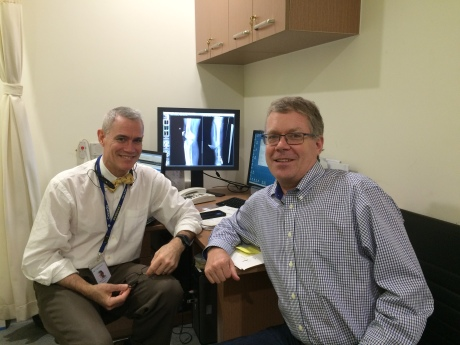 The orthopedic surgeon who helped me, Dr. Southern, and I and an X-ray of my healing leg.