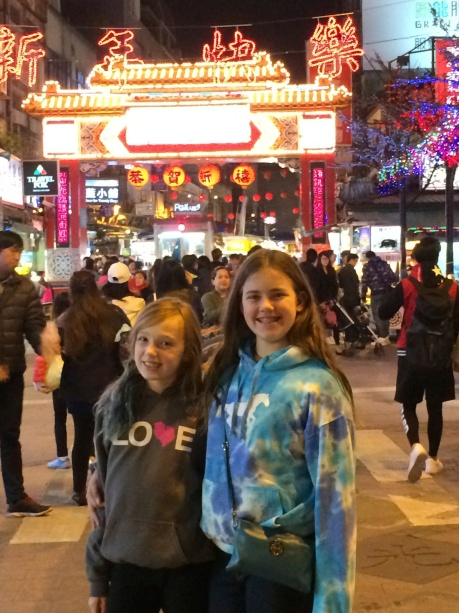 The girls getting ready to enter the Raohe night market in Taipei.